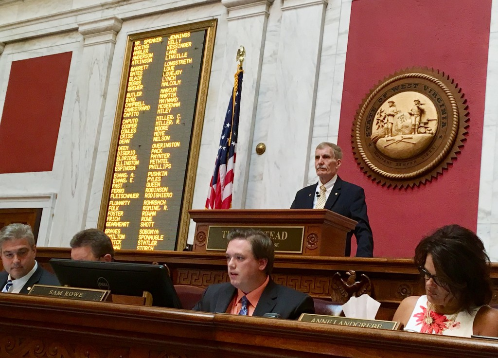 West Virginia House Speaker Pro Tempore John Overington, top, presides over the start of a hearing Monday, Aug. 13, 2018, at the state Capitol in Char...