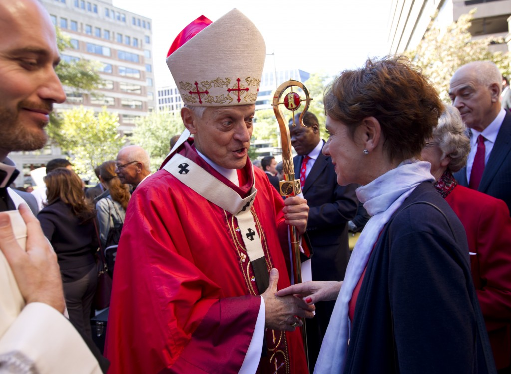 File-This Oct. 1, 2017, file photo shows Cardinal Donald Wuerl, Archbishop of Washington shaking hands with churchgoers at St. Mathews Cathedral after...