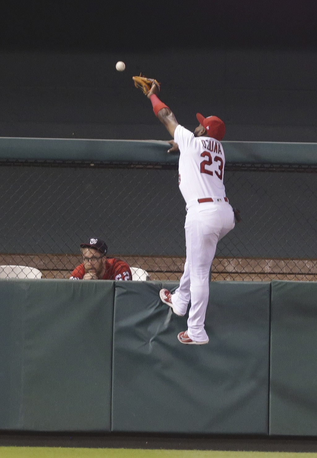 St. Louis Cardinals left fielder Marcell Ozuna (23) can't quite make the catch on a two-run home run ball hit by Washington Nationals' Juan Soto in th...