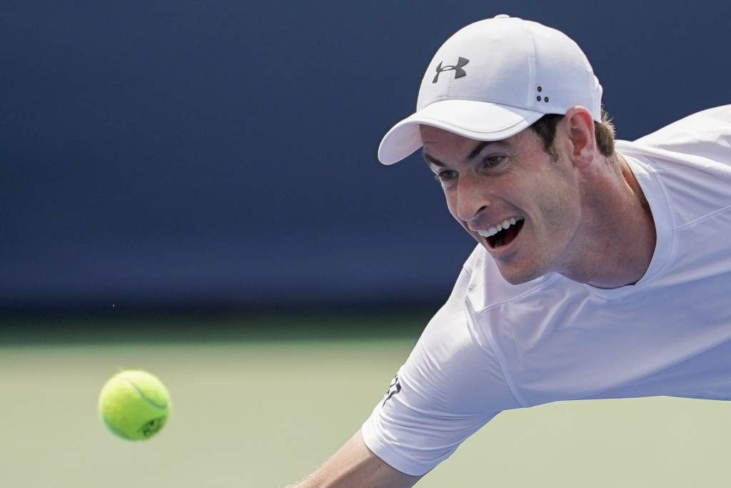 Andy Murray, of Great Britain, chases down a return from Lucas Pouille, of France, in the first round at the Western & Southern Open, Monday, Aug. 13,...