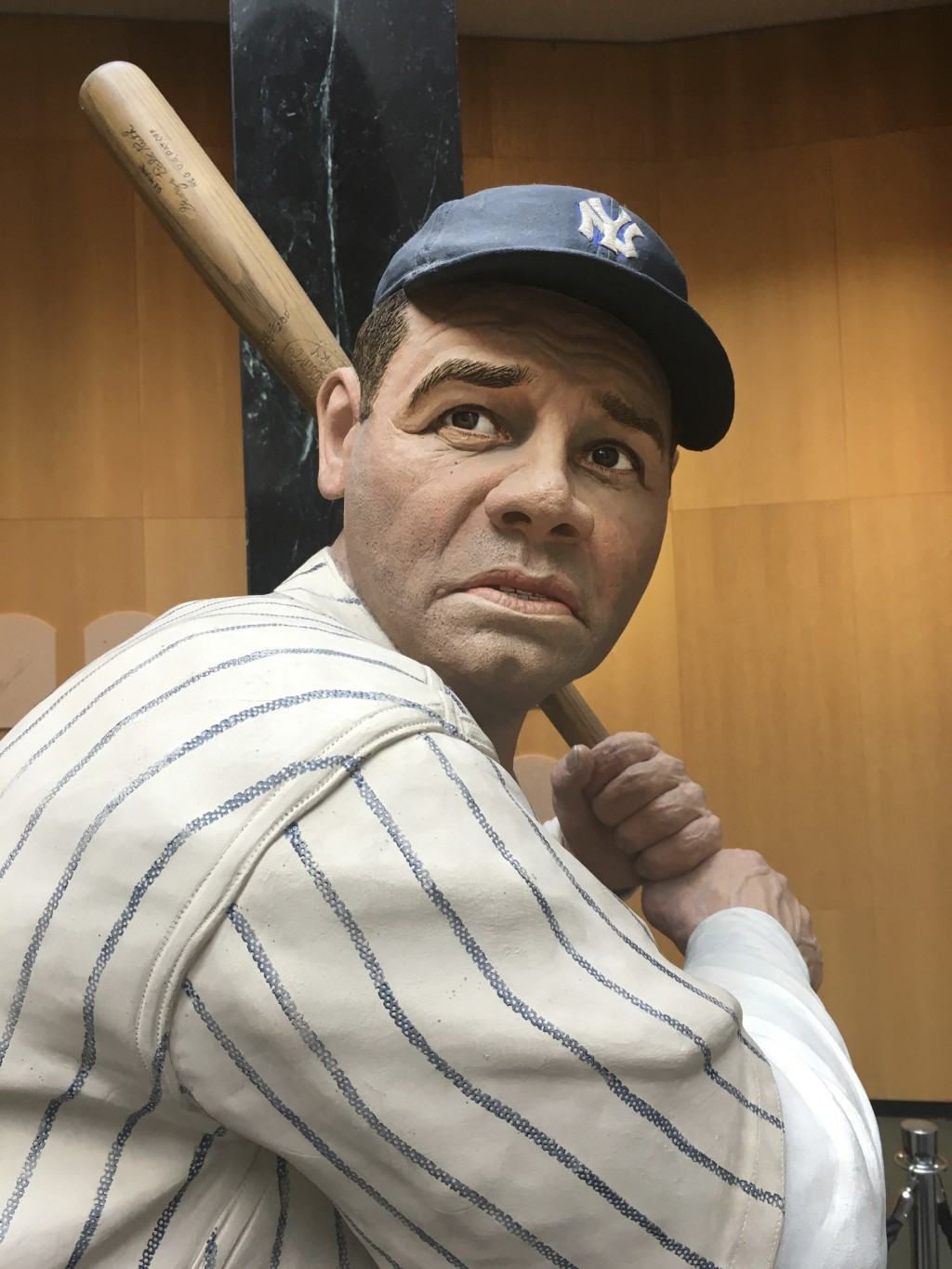 In this July 16, 2018 photo, baseball great Babe Ruth is depicted at bat, in a statue at the National Baseball Hall of Fame in Cooperstown, N.Y. There...