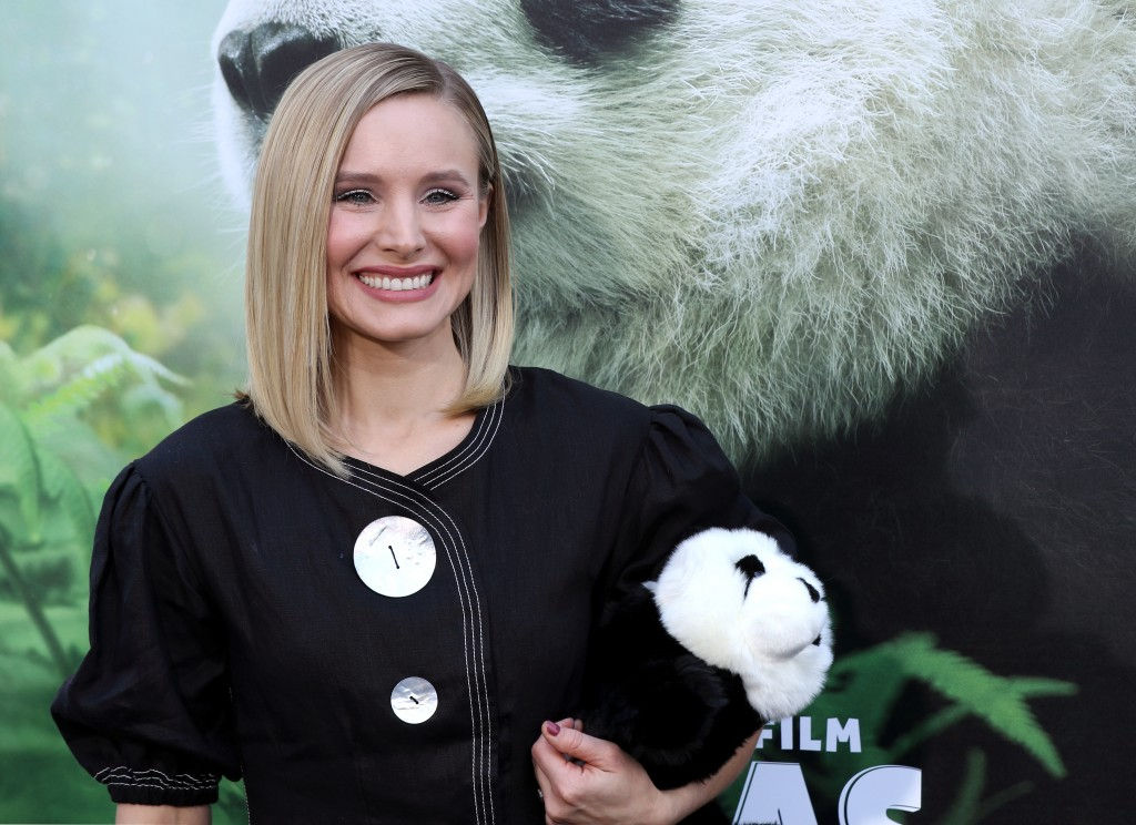 "FILE - In this March 17, 2018 file photo, Kristen Bell holds a stuffed panda teddy bear at the LA Premiere of ""Pandas"" in Los Angeles. Bell narrates t..."