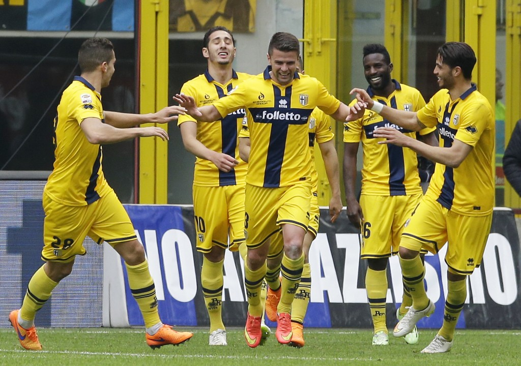 FILE -- In this April 4, 2015 file photo Parma's Andi Lila, center, celebrates with his teammates after scoring during the Serie A soccer match betwee...