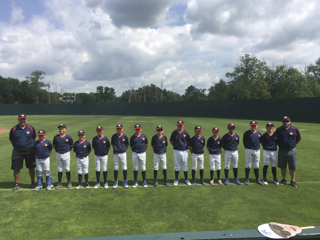In this July 15, 2018 photo, the Michigan Blue Jays Treat of Ann Arbor, line up for a photograph before playing a game at Cooperstown Dreams Park in H...