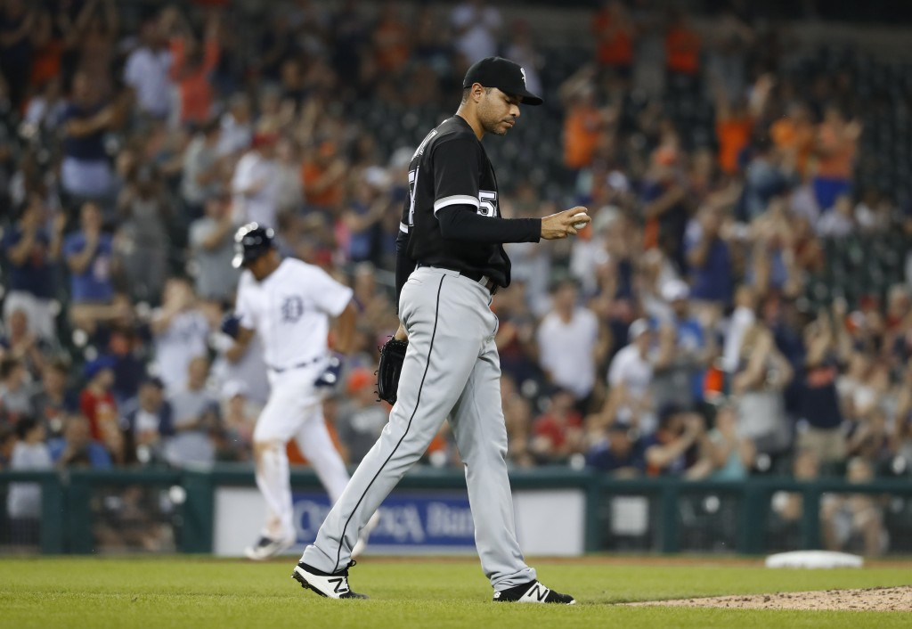 Chicago White Sox relief pitcher Jeanmar Gomez walks back to the mound after allowing a Detroit Tigers' Nicholas Castellanos two-run home run in the s...