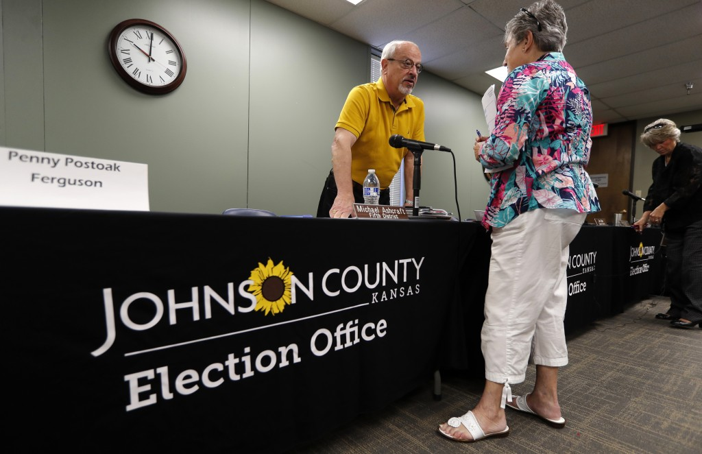 Board of County Commissioners 1st District Commissioner Ron Shaffer, left, talks with Barbara Holzmark, of Leawood, Kan., following the Johnson County...