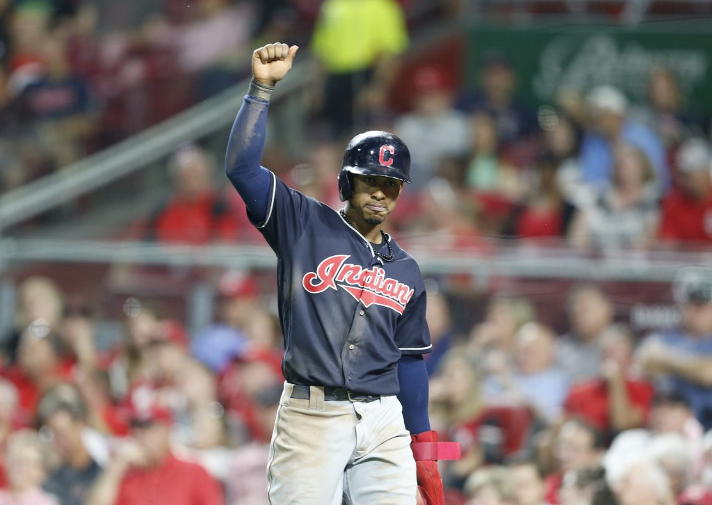 Cleveland Indians' Francisco Lindor reacts after scoring on a single by Melky Cabrera, off Cincinnati Reds relief pitcher Amir Garrett during the sixt...