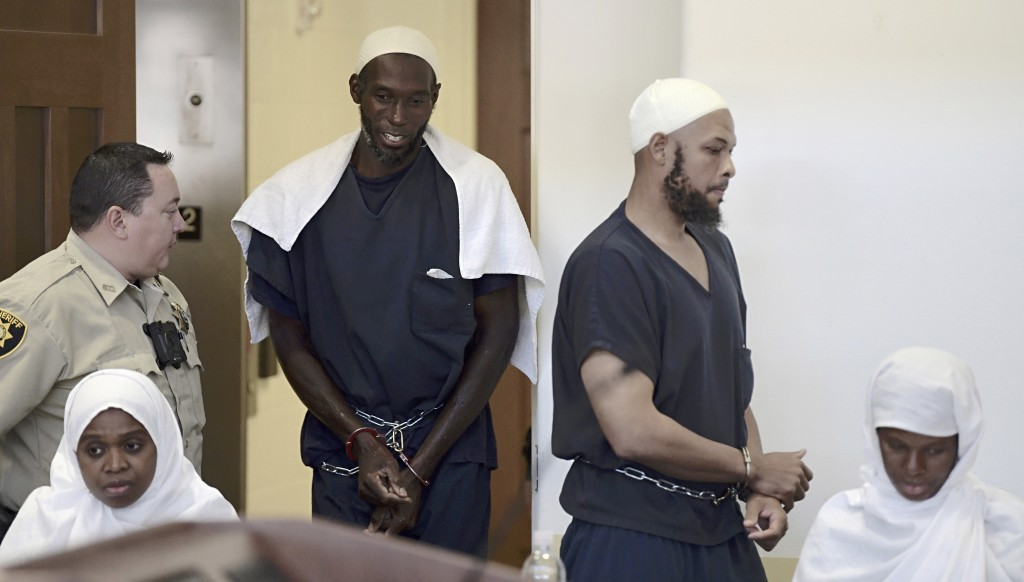 Defendants, from left, Jany Leveille, Lucas Morton, Siraj Wahhaj and Subbannah Wahhaj enter district court in Taos, N.M., for a detention hearing, Mon...