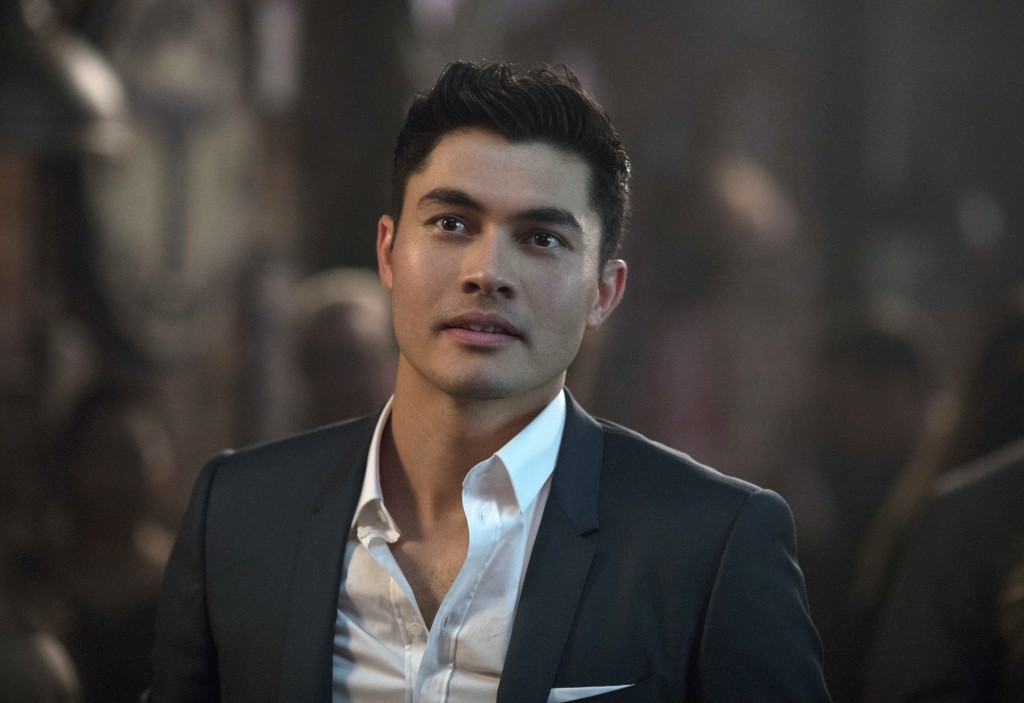"""This image released by Warner Bros. Entertainment shows Henry Golding in a scene from the film """"Crazy Rich Asians."""" (Sanja Bucko/Warner Bros. Entertai..."""