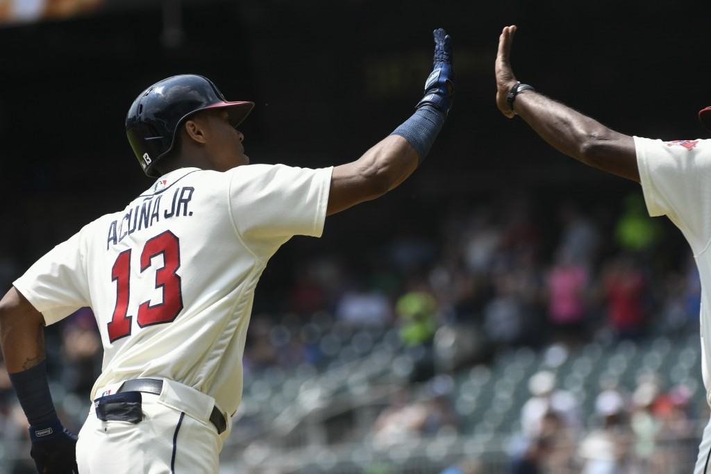 Atlanta Braves' Ronald Acuna Jr. (13) rounds third base on his home run during the first inning of the first game in a baseball doubleheader against t...