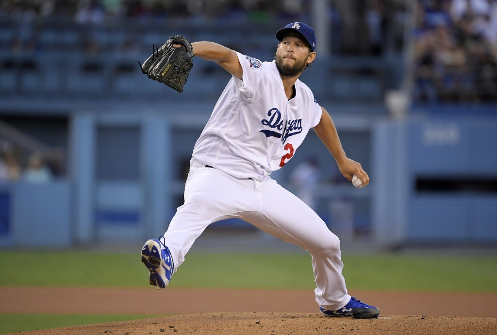 Los Angeles Dodgers starting pitcher Clayton Kershaw throws to the plate during the first inning of a baseball game against the San Francisco Giants M...