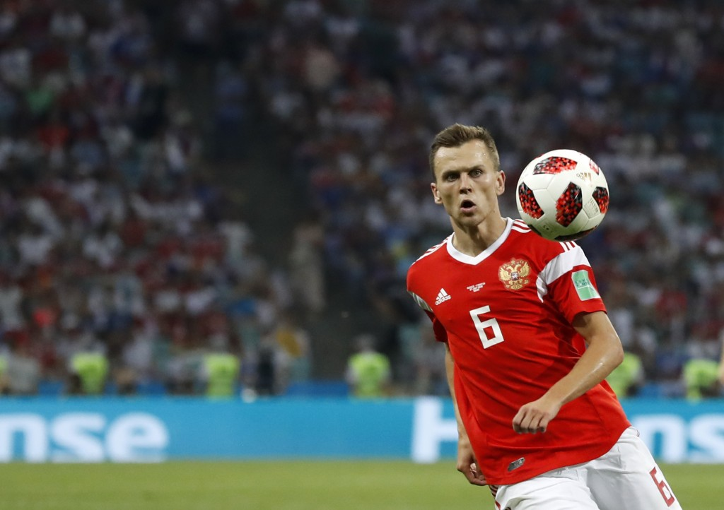 FILE - In this Saturday, July 7, 2018 file photo, Russia's Denis Cheryshev controls the ball during their quarterfinal match against Croatia at the 20...