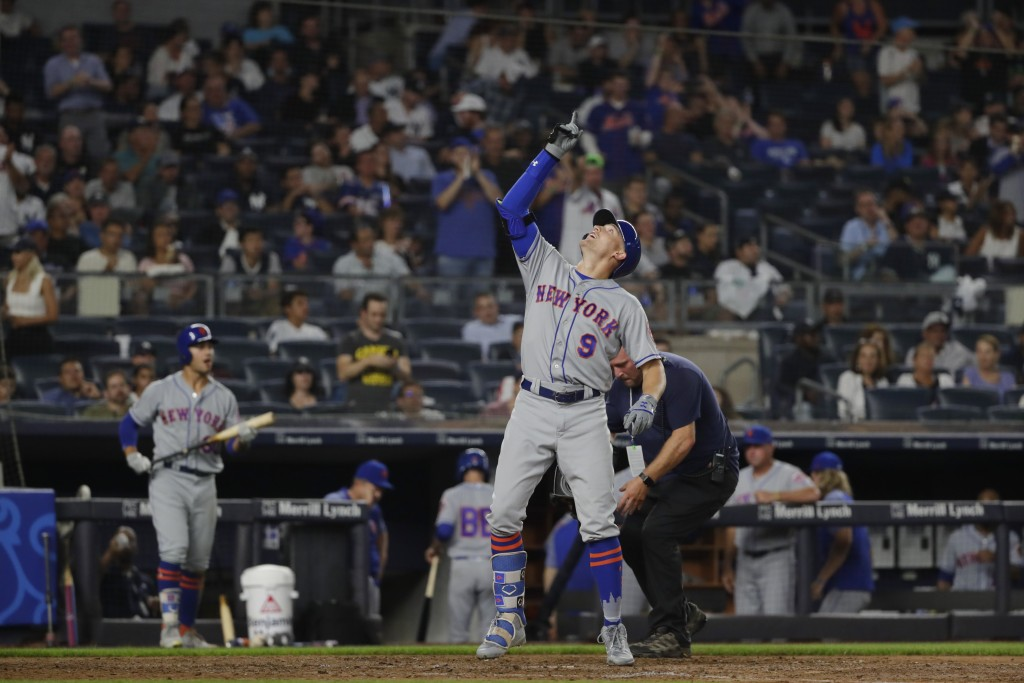 New York Mets' Brandon Nimmo (9) celebrates after hitting a home run during the seventh inning of a baseball game against the New York Yankees Monday,...