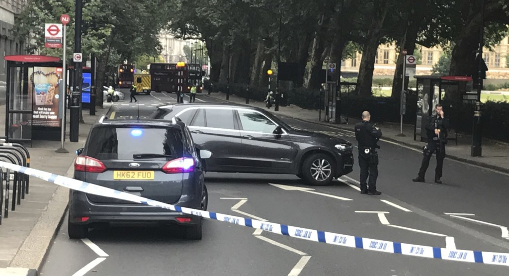 Police cordon off the area on Millbank, in central London, after a car crashed into security barriers outside the Houses of Parliament, in London,  Tu...