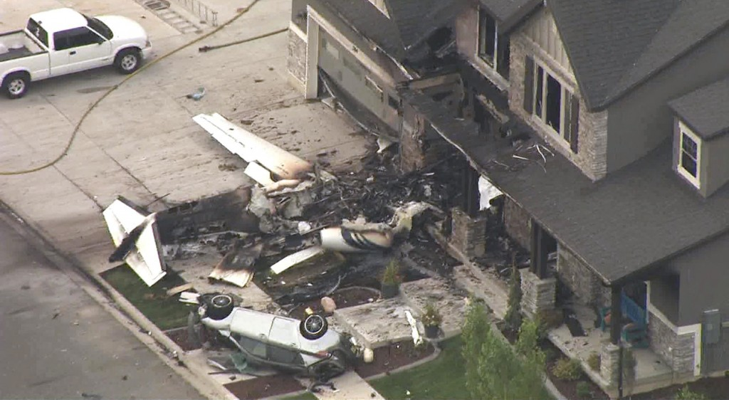 This frame from video shows the scene of a small plane that crashed into a house in Payson Utah on Monday Aug 13 2018. Authorities said the pilot