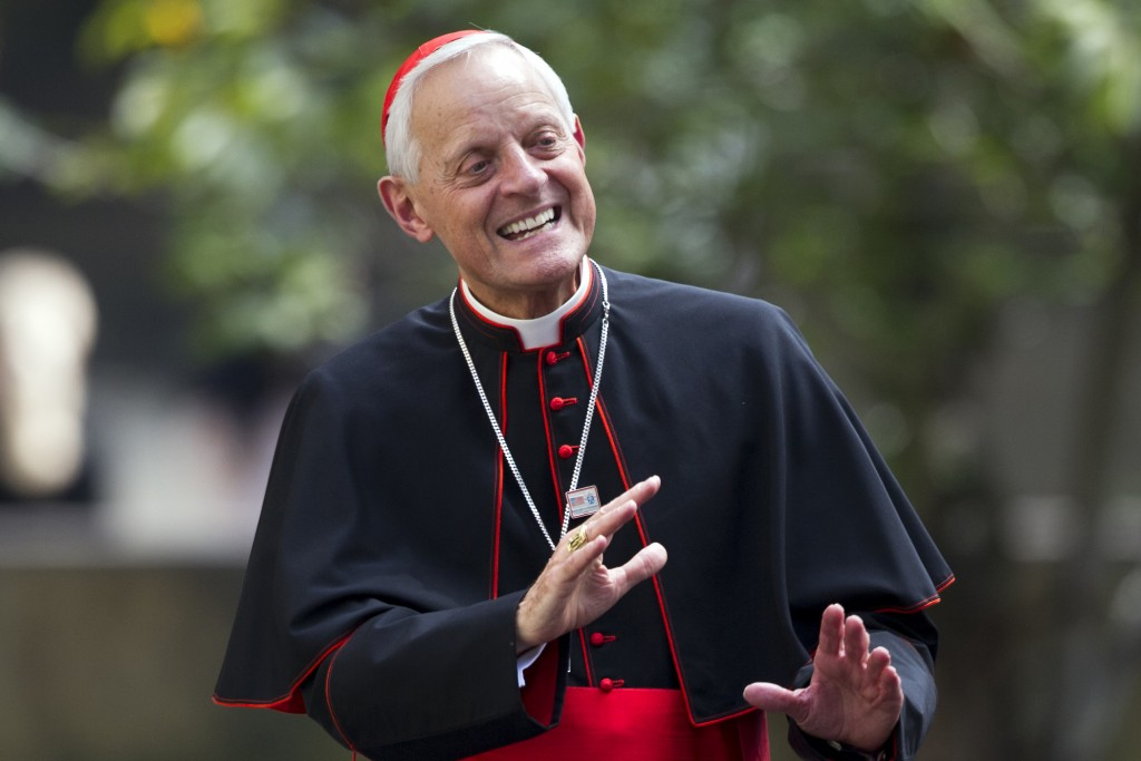 FILE – In this Sept. 24, 2015, file photo, Cardinal Donald Wuerl, archbishop of Washington, waves after he and Pope Francis arrived at the Apostolic N...
