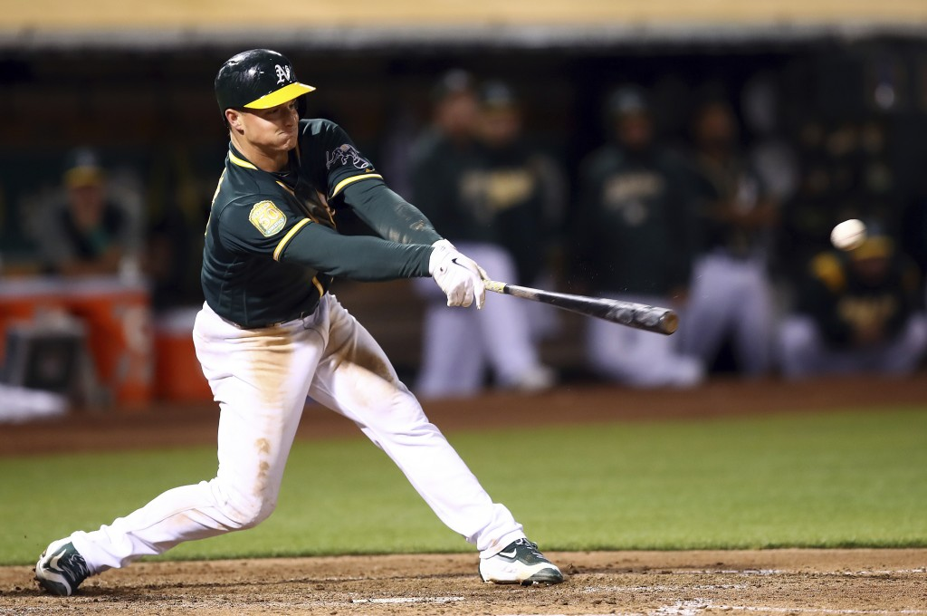 Oakland Athletics' Matt Chapman connects for a two-run double off Seattle Mariners' Casey Lawrence in the sixth inning of a baseball game, Monday, Aug...