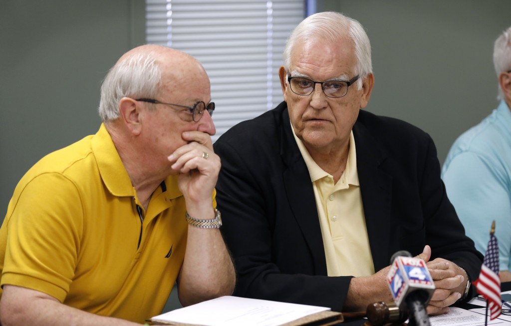 Board of County Commissioners chairman Ed Eilert talks with 1st District Commissioner Ron Shaffer, left, during the Johnson County Board of Canvassers...