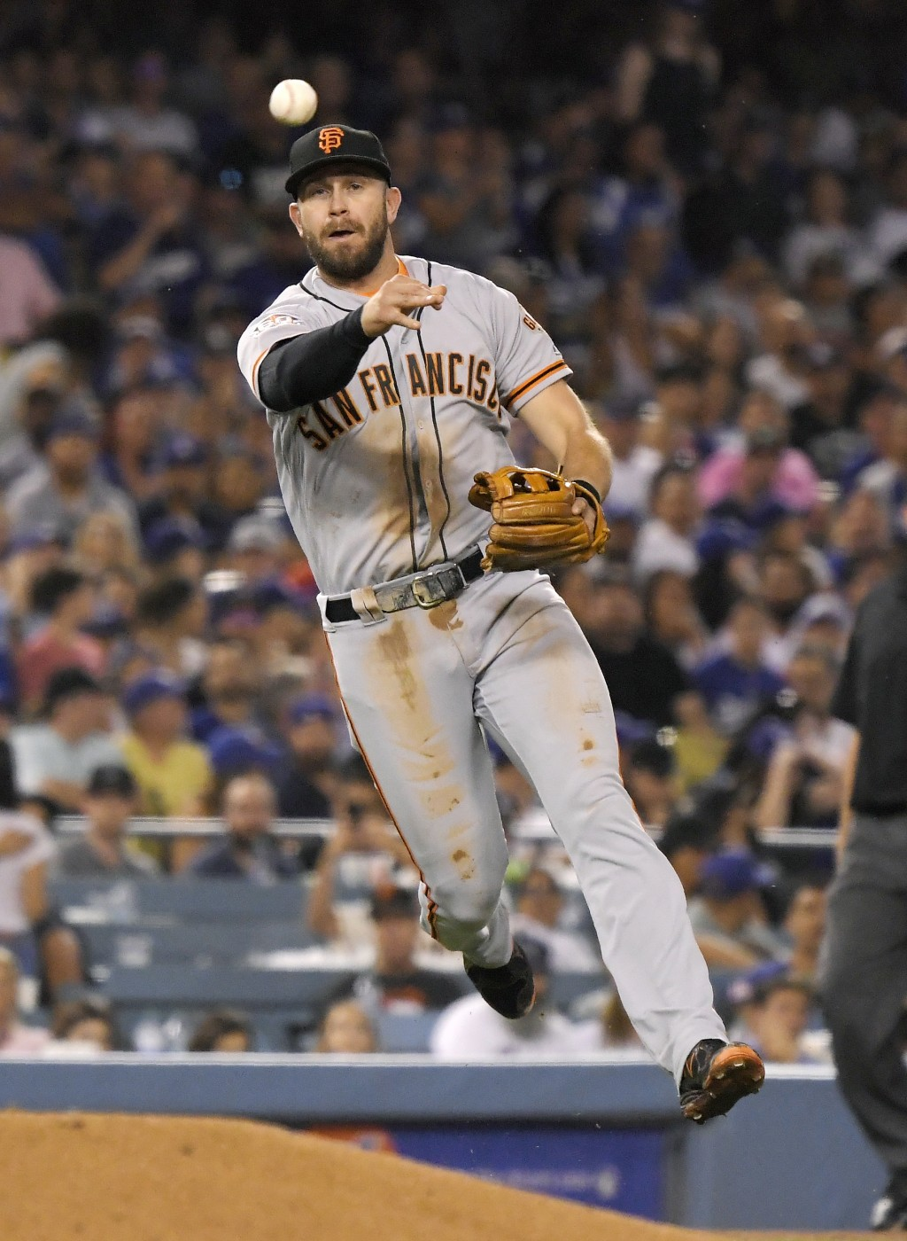San Francisco Giants third baseman Evan Longoria throws out Los Angeles Dodgers' Brian Dozier at first during the fifth inning of a baseball game Mond...