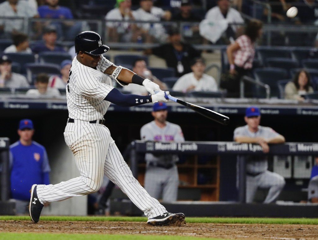 New York Yankees' Miguel Andujar hits a two-run home run during the eighth inning of a baseball game against the New York Mets Monday, Aug. 13, 2018, ...