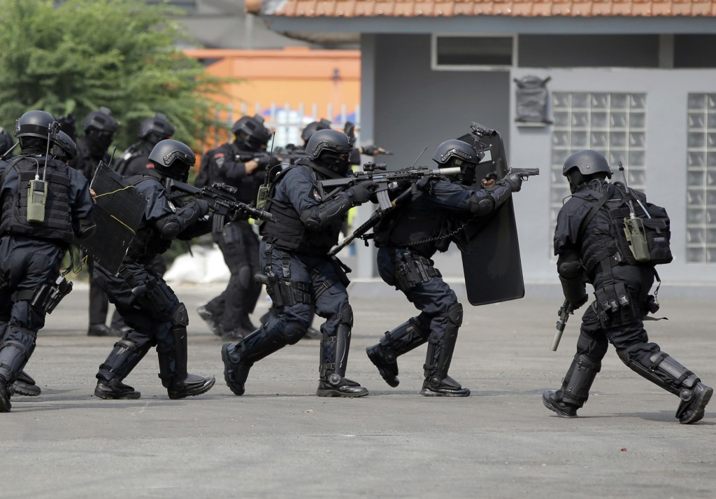 In this July 25, 2018, photo, members of joint Indonesian police and military special forces take part in an anti-terrorism drill ahead of the 2018 As...