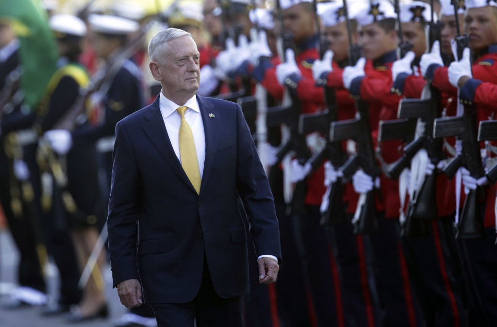 U.S. Secretary of Defense Jim Mattis receives military honors before his meeting with Brazil's defense minister, in Brasilia, Brazil, Monday, Aug. 13,...