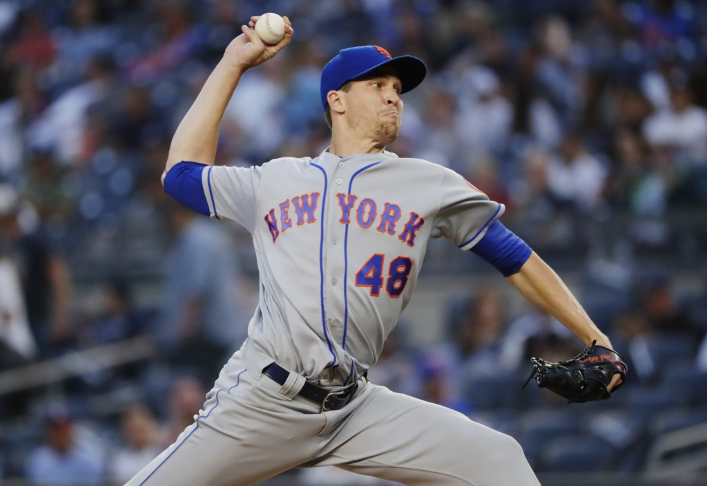 New York Mets' Jacob deGrom delivers a pitch during the first inning of a baseball game against the New York Yankees Monday, Aug. 13, 2018, in New Yor...