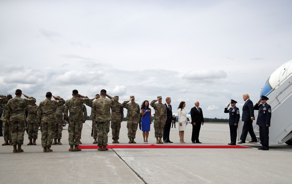 President Donald Trump arrives on Air Force One at Wheeler-Sack Army Air Field in Fort Drum, N.Y., Monday, Aug. 13, 2018. Waiting to greet the preside...