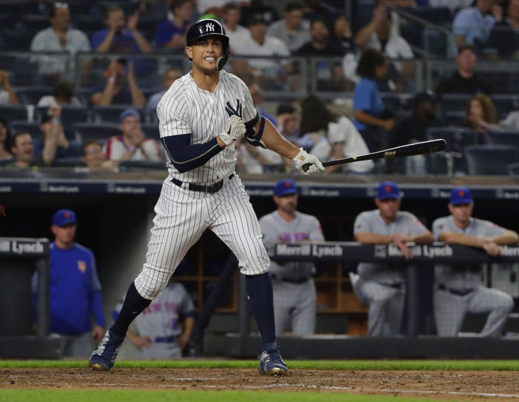 New York Yankees' Giancarlo Stanton reacts after striking out during the fifth inning of a baseball game against the New York Mets Monday, Aug. 13, 20...