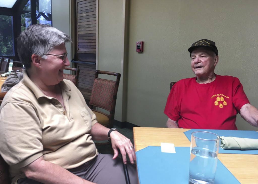 In this Monday, Aug. 13, 2018, photo Daniel Crowley, right, a 96-year-old U.S. Army Air Corps veteran from World War II who was held by Japan as a pri...