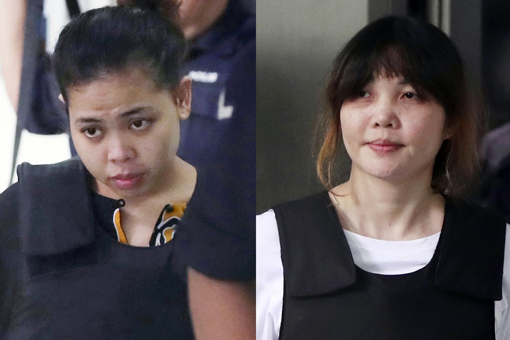FILE - This combination of the Oct. 2, 2017 file photos shows Indonesian Siti Aisyah, left, and Vietnamese Doan Thi Huong, right, escorted by police a