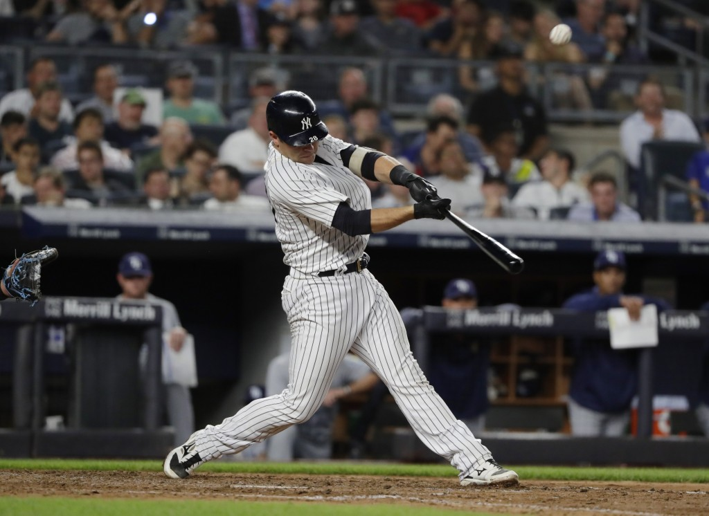 New York Yankees' Austin Romine hits a two-run home run during the fifth inning of a baseball game against the Tampa Bay Rays Tuesday, Aug. 14, 2018, ...
