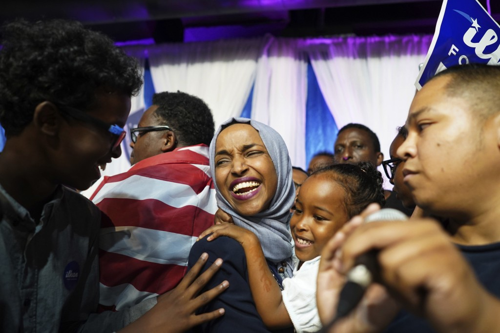 Minnesota Rep. Ilhan Omar, center, celebrates with her children after her Congressional 5th District primary victory, Tuesday, Aug. 14, 2018, in Minne...