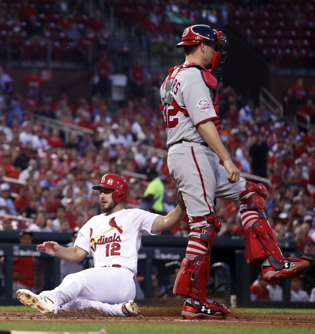 St. Louis Cardinals' Paul DeJong, left, scores past Washington Nationals catcher Matt Wieters during the second inning of a baseball game Tuesday, Aug...