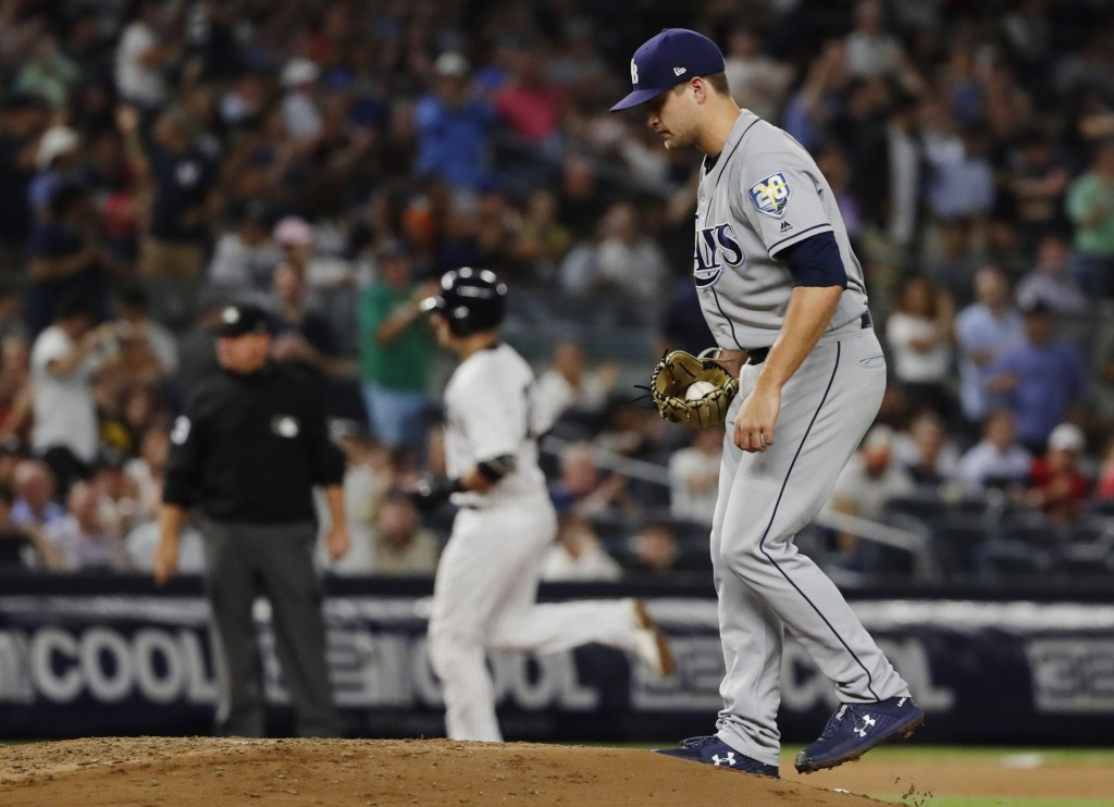 Tampa Bay Rays starting pitcher Jalen Beeks reacts as New York Yankees' Austin Romine runs the bases after hitting a two-run home run during the fifth...