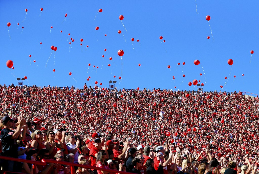FILE- In this Sept. 26, 2015, file photo, balloons are released after a Nebraska touchdown against Southern Miss during the first half of an NCAA coll...