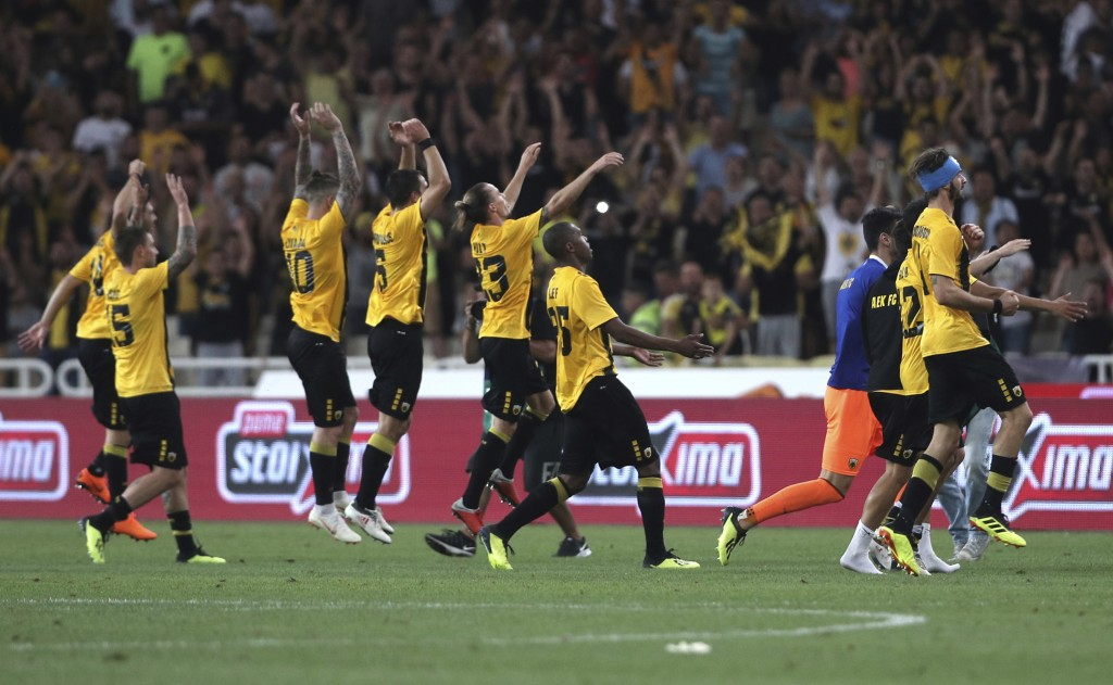 AEK Athens' celebrate their win after a Champions League third qualifying round, second leg, soccer match between AEK Athens and Celtic at the Olympic...