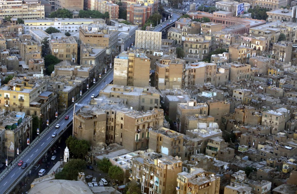 This July 18, 2014 photo, shows buildings, to the right of the bridge, that are to be demolished as part of a redevelopment plan in the Maspero neighb...