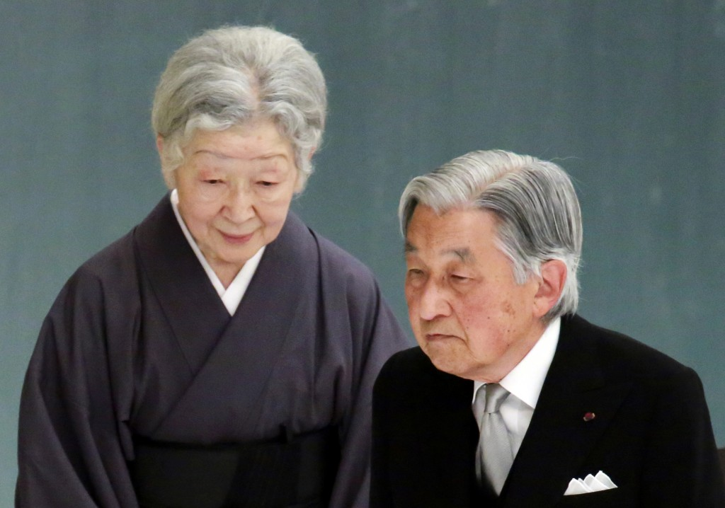 In this Wednesday, Aug. 15, 2018, photo, Emperor Akihito, right, and Empress Michiko, attend a memorial service for the war dead at Nippon Budokan mar...