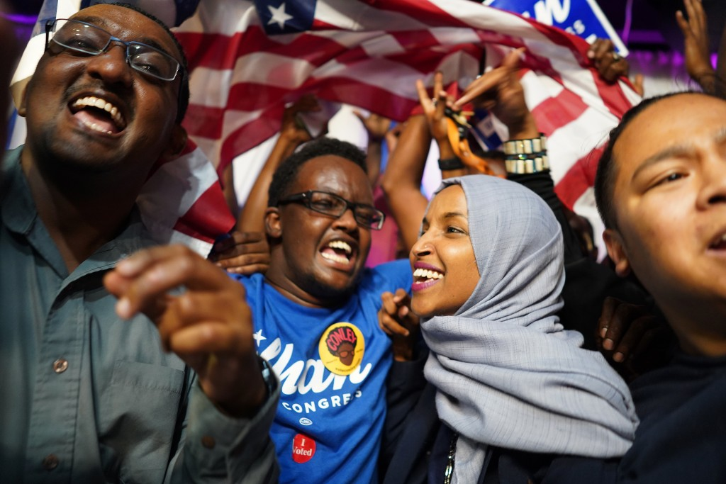 Minnesota Rep. Ilhan Omar, second from right, celebrates with her supporters after her Congressional 5th District primary victory, Tuesday, Aug. 14, 2...