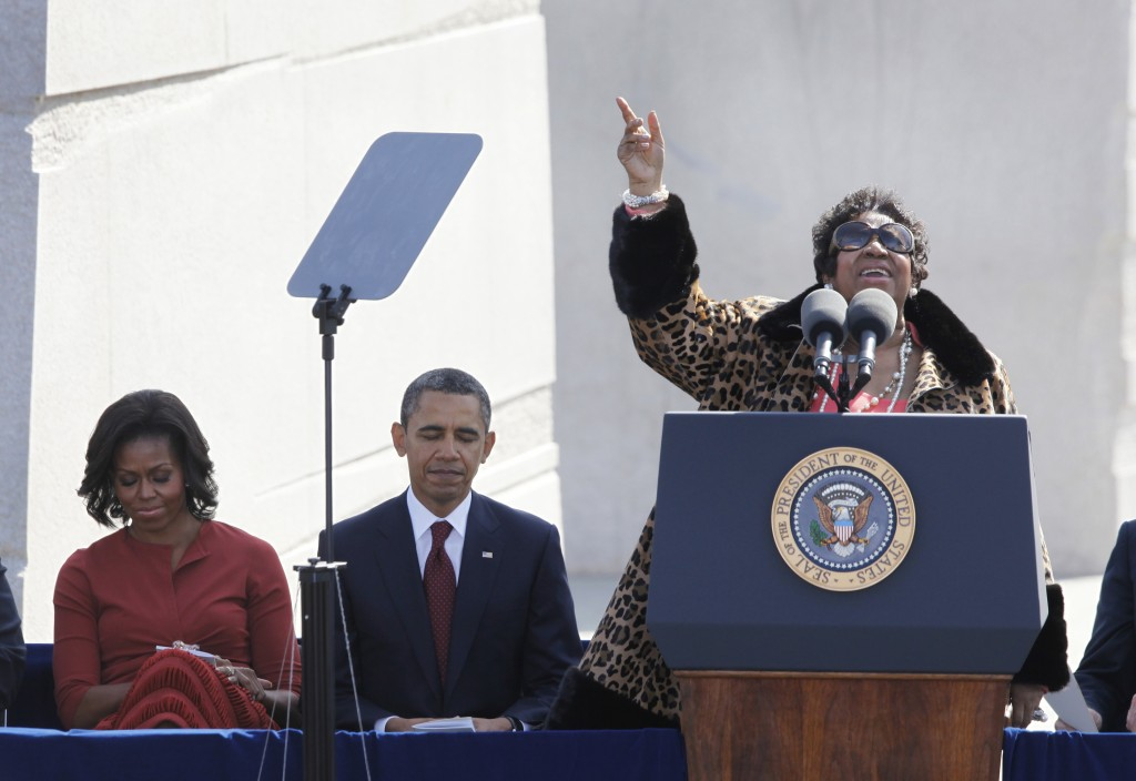 FILE - In this Oct. 16, 2011 file photo, Aretha Franklin sings as President Barack Obama and first lady Michelle Obama look on during the dedication o...