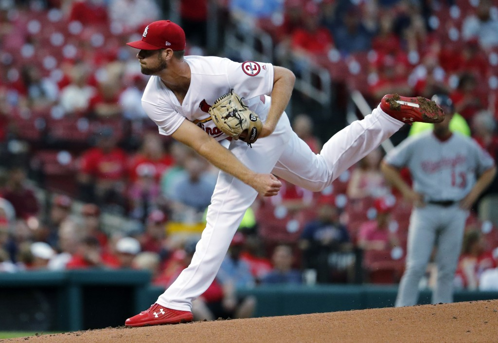 St. Louis Cardinals starting pitcher John Gant throws during the first inning of a baseball game against the Washington Nationals Tuesday, Aug. 14, 20...