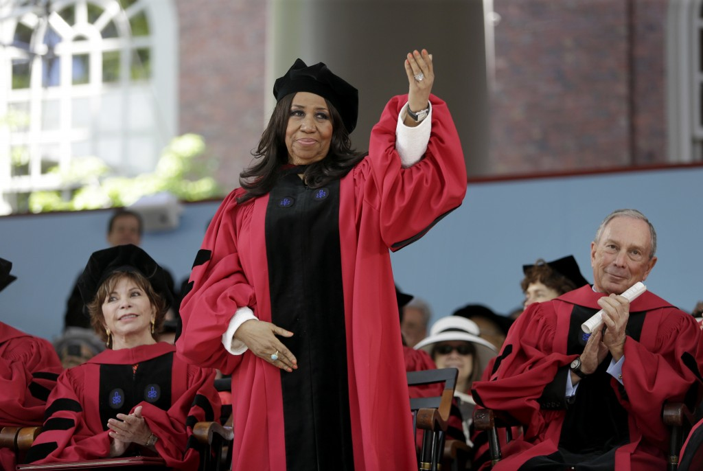 FILE - In this May 29, 2014 file photo, singer Aretha Franklin waves as she receives an honorary Doctor of Arts degree as Chilean author Isabel Allend...