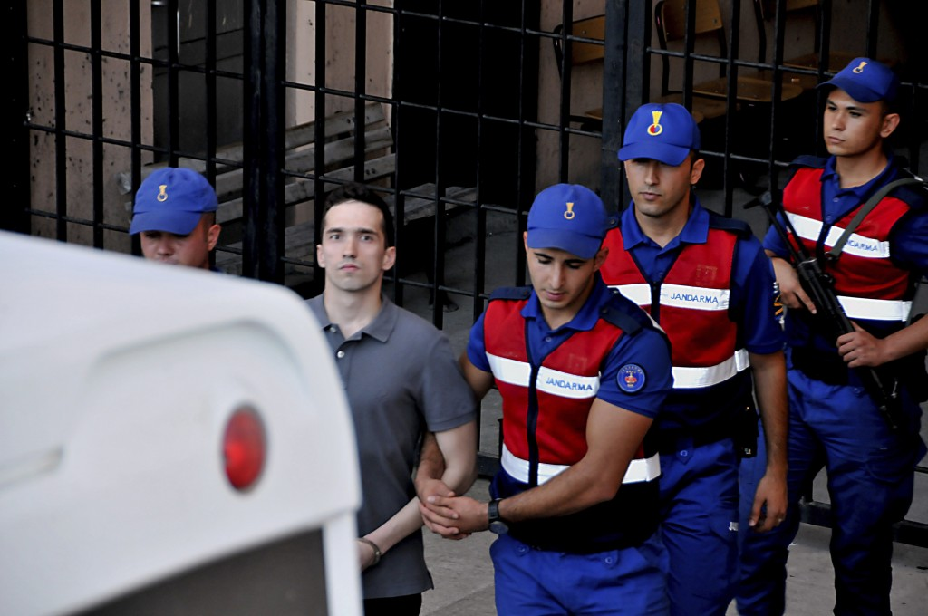 Turkish paramilitary police officers escort Greek soldier Aggelos Mitretodis following a court appearance in Edirne, Turkey, Tuesday, Aug. 14, 2018. T...