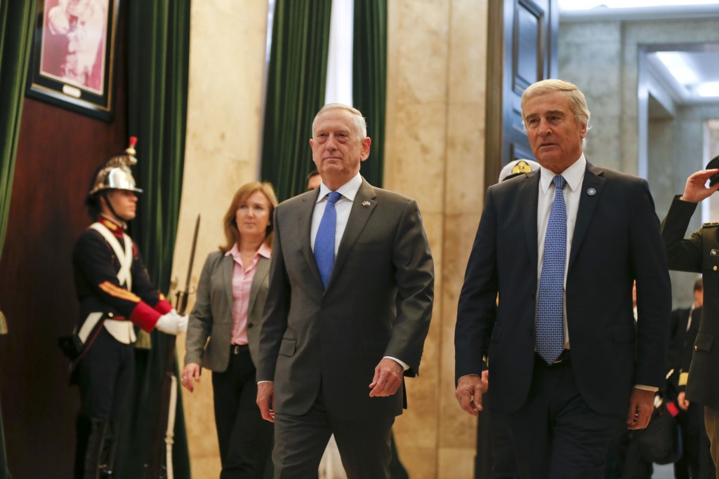 U.S. Secretary of Defense Jim Mattis, left, and Argentina's Defense Minister Oscar Raul Aguad arrive for a press conference in Buenos Aires, Argentina...