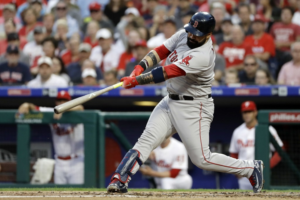 Boston Red Sox's Sandy Leon follows through after hitting a home run off Philadelphia Phillies starting pitcher Nick Pivetta during the third inning o...