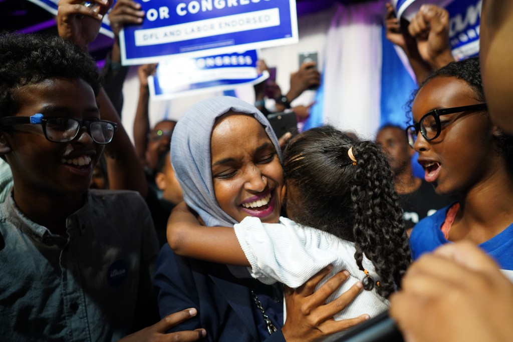 Minnesota Rep. Ilhan Omar celebrates with her children after her Congressional 5th District primary victory, Tuesday, Aug. 14, 2018, in Minneapolis. (...