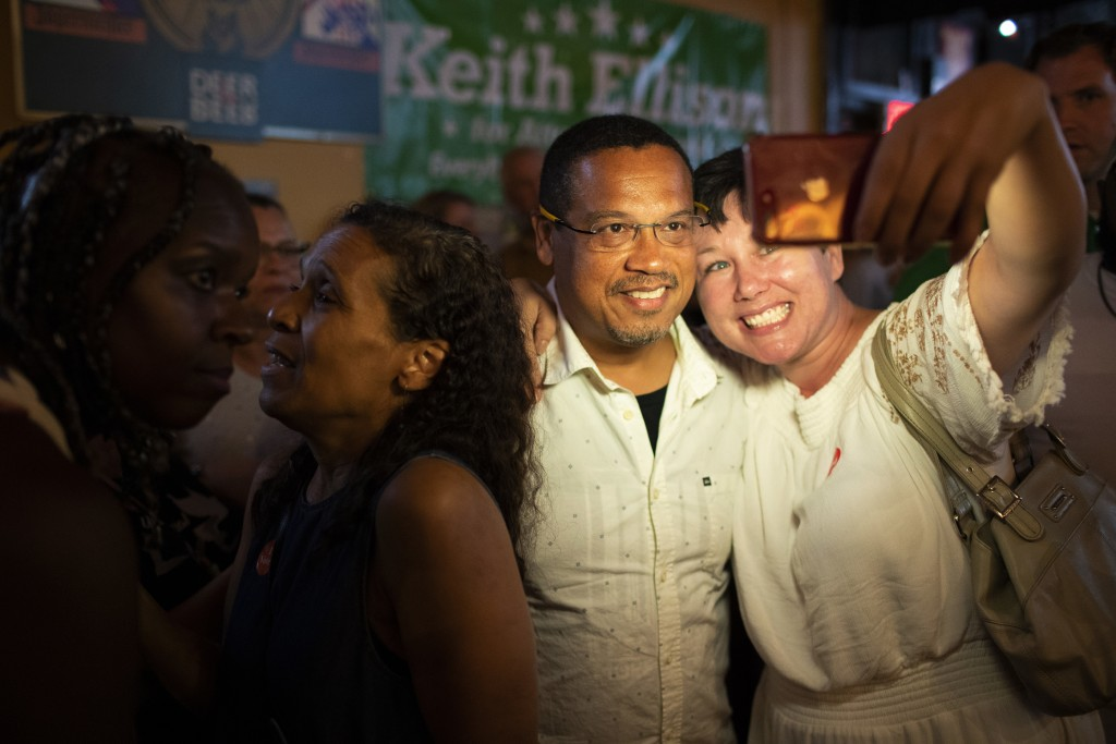 Rep. Keith Ellison poses for a selfie with Jennifer Lindquist after winning the Democratic nomination for Attorney General during his primary party at...