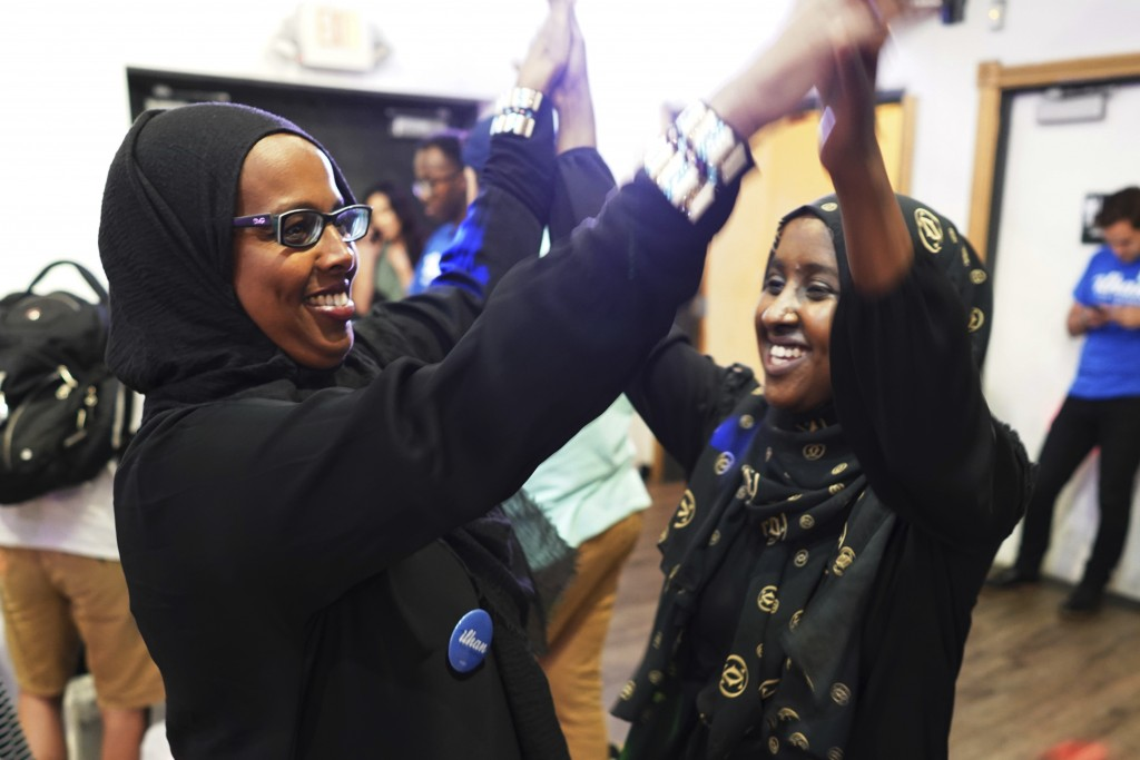 Degha Shabbeleh, left, and Maymuna Sahal, supporters of Congressional District 5 candidate Ilhan Omar, celebrate incoming results at Safari Restaurant...