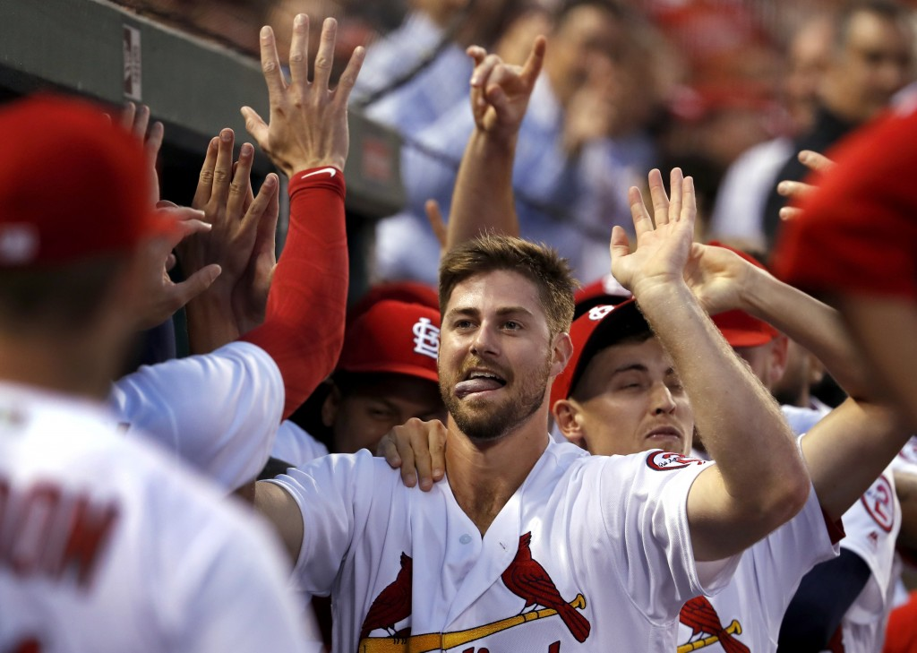 St. Louis Cardinals' John Gant is congratulated by teammates after hitting a two-run home run during the second inning of a baseball game against the ...